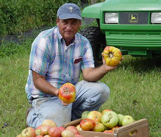Randy Gardner with heirloom tomatoes